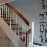 Treppenkonstruktion mit Massivholzstufen aus Nussbaum